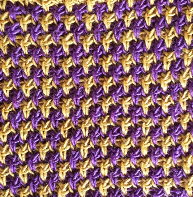 Color change with Tunisian knit stitch and twisted down simple stitch