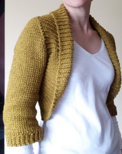 Vaillance, boléro au crochet tunisien, design Rachel Henri