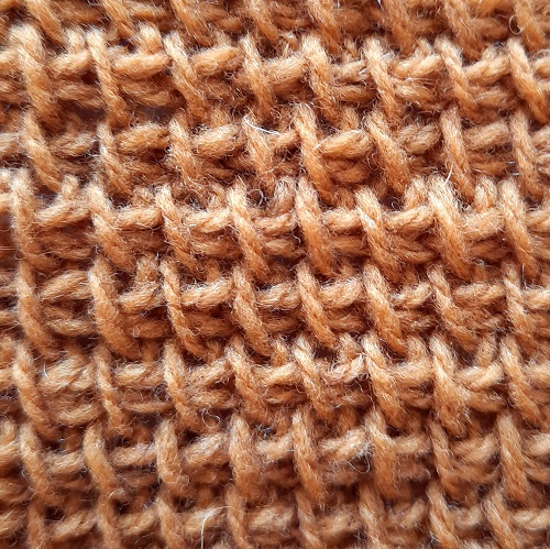 Tunisian simple stitches made with a yarn under
